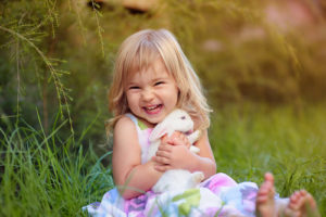 cute little girl with pet rabbit